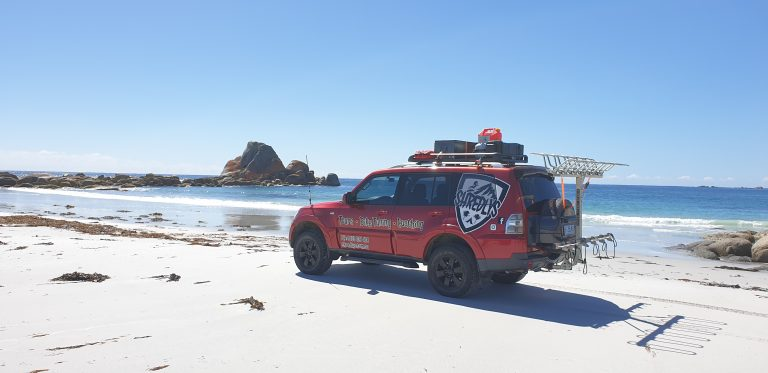 Pajero 4x4 off road tour bus on Bay of Fires beach driving - MTB Tasmania